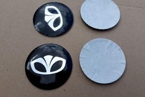 Наклейки эмблемы дисков металлические с логотипом Daewoo 56 мм